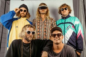 """""""The guitar hook at the chorus is so catchy and the message of [Witness The Eucalyptus] is a great little wake up call and reminder to enjoy the beautiful world we live in!"""" - Claire Mooney, Triple J """"Everyone's favourite Byron Bay jammers"""" -Savage Thrills """"Drop Legs are (or are damn sure about to be) everyone's favourite coastal chill/hip hop/reggae sensation. They're smooth, clever and funky, and you need them in your playlist."""" - Erica Mallett, Triple J Grab your sunscreen and get Slip-Slop-Slapping, five-pieceDrop Legsare back with an absolute scorcher of a single, premiered ontriple j Unearthed'sTOPS, just in time for the weekend! Now added as the main support for fellow Byron Bay nativeTones and I's near sold out tour, these jammers will be bringing the heat all down the east coast throughout May and June. Their first single since the release of their debut albumKingBrownSunDownin October last year, 'Witness The Eucalyptus' is an explosive brass filled, dub, surf-rock, hip-hop fusion of gnarly proportion. Deep, skating bass tones andlaidback boom bap percussion lay the foundation,accented by effortlessly smooth melodies and a string of raucousrap bravado; a testamentthat Drop Legs' style is captivating to say the least. Encouraging others to disconnect from technology, the song is about the materialobsession with devices which blind us to the beauty that surrounds. The concept came to lead vocalistHamBlacketafter teaching and performing alongside the AboriginalNgarluma and Yinjibarnrdi peoplein the rural Western Australia,""""I was amazed by the local culture and the connection with land and spiritual world,""""he explained. 2018'sKingBrownSunDownsaw the quintet reach new heights, scoring multiple spins on triple j, and support from the likes ofPilerats,BeatMagazineandSavageThrills. The last 12 months alone has seen them play festivals across Europe, New Zealand and Australia includingBoom Town Fair(UK),Party In the Paddock,FallsFestival,IslandVibes,SoundSplash(NZ) """