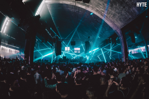 The flagship HYTE festival returns to its stunning industrial home on 31st December Reigster for tickets https://bit.ly/2H87huo Date December 31 2019, 18:00 – January 01 2019, 18:00 Location Funkhaus Berlin, Nalepastraße 18, 12459 Berlin, Germany HYTE NYE Berlin is now a fixed date on the annual rave calendar. The flagship HYTE festival will return to the immense warehouse surrounds of Shedhalle at Funkhaus, a venue like no other, for another of its stock-in-trade marathon events featuring a cast of the underground elite alongside its hyped newcomers. Expect an exceptional celebration with the lineup and production to match the reputation of HYTE worldwide. This 2019 edition of HYTE NYE represents its sixth NYE gathering in Berlin where the underground festival brand will utilise the world-famous Funkhaus once again. The venue became the signature home of the Berlin-based, but worldwide touring festival series, it's a venue that is steeped in the city's proud tradition of re-appropriating old spaces and transforming them into hubs of music and culture. A former GDR complex, characterized by monumentality and the typically austere grandeur of Soviet architecture, situated right on the River Spree, which once housed the radio and TV headquarters of communist East Germany. Central to HYTE NYE is the tremendous Shedhalle, which is one part of Funkhaus, a vast warehouse space encircled by a mezzanine level and flanked by formidable steel girders and cavernous arched ceilings. It perfectly embodies the industrial grit and grandeur of Berlin's most beloved venues, and it provides a unique, one-of-kind setting for the most anticipated HYTE event of the year. These sprawling surrounds will be brought to breathtaking life by the HYTE trademark commitment to lighting, sound and production. Forging a connection between performer and crowd that allows its carefully-curated lineups to shine in their full glory, it's the same HYTE magic that is on display at events in every corner