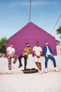"""East London luminaries, Rudimental have today announced that, due to scheduling conflicts, their highly anticipated Toast To Our Differences Australian tour will be rescheduled for May/June 2019. The tour will now see Rudimental play Metro City in Perth on May 31, before moving through to Adelaide, Mt Gambier, Brisbane, Sydney, Darwin, and wrapping up at Margaret Court Arena in Melbourne on Sunday June 9. The group have also announced that beloved Australian dance pop group Sneaky Sound System will be on support duties for the tour. Rudimental's new album Toast To Our Differences was released Friday January 25. Sneaky Sound System have been household names in Australia since the mid-2000s, with massive hits UFO, Pictures and I Love It spearheading their 3x platinum self-titled album. In a swirling midst of albums, tours and multiple ARIA nominations, lead vocalist Connie even lent her voice and lyrics to superstars Kanye West, Jay-Z and Snoop Dogg. Sneaky Sound System take listeners on a house music journey; from slow chugging burners to groove‐laden euphoria, amplified by Connie's sublime vocals… it's the sound of summer. For those fans who have already purchased tickets, please hold onto them as these tickets will still be valid for the rescheduled shows in the same city. For any ticket purchasers unable to attend on the rescheduled dates, a refund will be available from point of purchase. Remaining tickets are on sale now (links below). Speaking on the new tour dates, Rudimental's Locksmith says, """"To our Aussie fans – we're so sorry we have had to reschedule our trip down under, but we're excited to see you later in the year – and to be bringing our friends Sneaky Sound System along, too. It's going to be a serious party!"""" With over 1.4 billion global streams, 20 million single sales, 40 platinum awards, 22 million monthly listeners on Spotify (ranked 55thartist in the world), 700 million YouTube views and a global audience of 1.5 million+ across socials, there i"""