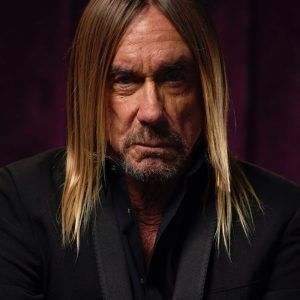 "Iggy Pop has unveiled the first video from his upcoming album ​Free​ – out September 6 via Caroline Australia. Directed by Simon Taylor, the clip for 'James Bond' was shot on location at Sweat Records in Miami. 'James Bond' is the second song to be released in advance of the new album, and has been hailed ""infectious""​ by ​PASTE​ and by ​CONSEQUENCE OF SOUND: ​""a stylistic shift... magnetic."" In Iggy's own words, 'James Bond' tells a story: ""I don't know what she's up to exactly, but the tables seem to be turning, and she's taking over. Well, why not? I'll try anything once. I've never had more fun singing a lyric. Faith's reading is so loaded, and Leron's production and trumpet along with the band swings like crazy."" Credits: Iggy Pop - Vocal Faith Vern - Additional Voice Leron Thomas - Trumpet Robin Sherman - Bass Thomas Glass - Drums Ari Teitel - Guitar Simon Taylor - Video Director WATCH 'JAMES BOND' [VIDEO] While Free follows the highest charting album of Iggy's career, 2016's Grammy-nominated Post Pop Depression, it has virtually nothing in common sonically with its predecessor—or with any other Iggy Pop album. As The New York Times remarked upon hearing the title track: ""Iggy Pops 'Free' is brief, atmospheric and elusive. Amid sustained electronic tones from the guitarist Noveller and ghostly overdubbed Miles Davis-tinged trumpet lines from Leron Thomas, Pop's voice appears only a few times, intoning, 'I wanna be free.' As the title song and opening track of an album due in September, it could lead anywhere."""